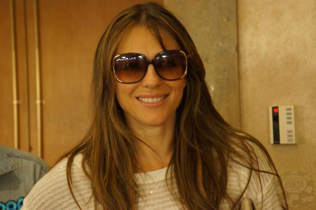 Article image for: WHY IS ACTRESS ELIZABETH HURLEY SMILING?