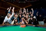 Newly crowned 2010 WSOP Ladies Champion, Vanessa Hellebuyck, lets loose while posing with her supporters.