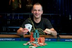 Steve Jelinek poses with the bracelet after taking down event #41