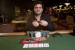 Tomer Berda proudly displays his newly won bracelet after shipping event #56