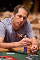 Phil Gordon tosses some chips into the pot.