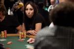 Karina Jett stares down her opponent before deciding on her hand.