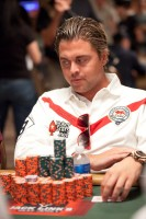 William Thorson has a hard time seeing his opponent over his growing stack of chips.