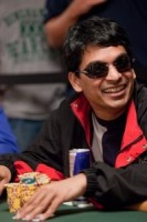 Venkatesh Gupta smiles at his opponent before making his next move.