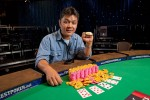 Yan Chen shows off his new WSOP bracelet as the winner of Event 14