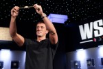Carter Phillips holds his WSOP Bracelet up high for all to see