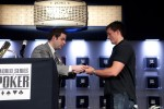 WSOP Tournament Director Jack Effel congratulates Carter Phillips on his win and presents him with his bracelet