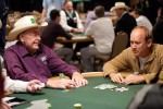 Doyle Brunson and Avery Cardoza chat over a hand in Event 19
