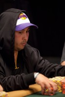 Christopher Gonzales celebrates a Lakers victory and has quite a chip stack of his own