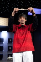 Ayaz Mahmood holds up his gold bracelet