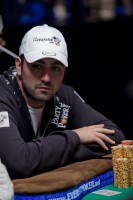 Joel Ettedgi sits in Seat 1 of the final table with his large stack of chips