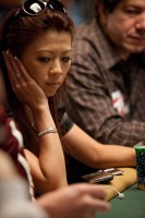 Liz Lieu watches her table-mate count out chips