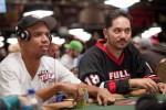 Phil Ivey and Steve Wong look up to hear what the dealer has to say. (That or a pretty girl walked by)