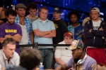 Event 52 rail-birds stand behind Vadim Trincher and Martins Adeniya.