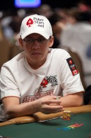 Darus Suharto waits for the first hand to be dealt on day 1B!
