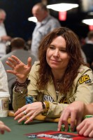 Annie Duke prepares for her cards to be dealt to her.