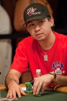 Kenny Tran stacks and shuffles his chips.