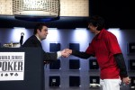 Tournament Director Jack Effel congratulates Event 35 Bracelet Winner Ayaz Mahmood