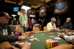 Tournament winner Hoai Pham plays a hand at one of the final tables.