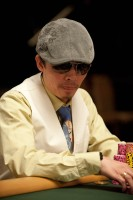 Hoai Pham, the winner of event 1, watches play at the final table.