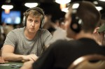 Erik Sagstrom listens to music as he ends the day as the chip leader.