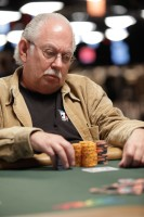 Lyle Berman eyes his chip stack on day 4 of event 2.