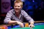 Derric Haynie laughs while playing a hand at the final table of Event 14.