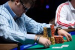 Craig Bergeron checks out his chips while at the final table of event 16.