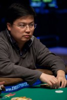 Wenlong Jin plays a hand at the final table of event 47.