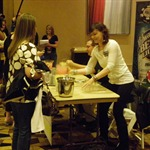 Annie Duke sells lemonade to an eager patron. There were no shortage of customers in Duke's line, while Norman Chad was quite so fortunate!