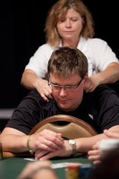 Sigurd Eskeland receives a massage while trying to cope with the pressure of the Main Event.