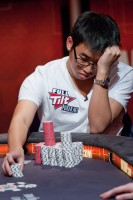 Ronald Lee being put to one of many tough decision during three-handed play. Despite having a 3 to 1 chip lead over his nearest opponent when play came down to three, Lee was eliminated in third place.
