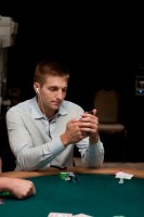 Tony Dunst is listening to music, checking his phone and playing poker.