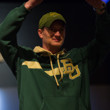 Jared Hamby holds his gold bracelet aloft