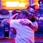 Chris Treyba gets a hug from Sean Stevens after winning his bracelet.