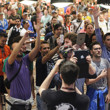 Friends of Davide Suriano sing the Italian National Anthem during his bracelet ceremony