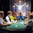 Antonio Esfandiari sitting beneath the photo of him from The Big One for One Drop