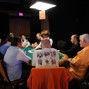 Table 367:  Tom McEvoy, Joe Cada, and chip leader coming into Day 2c Randy Haddox