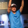 Brandon Wong holds his gold bracelet aloft
