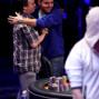 John Hewitt, right, gets a hug from November Nine chip leader Martin Staszko.