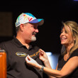 Julie Schneider smiles from ear to ear after husband Tom wins 4th bracelet