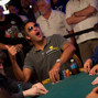 Brad Garrett strains his next to see his cards, then shows them to the rail prior to folding.