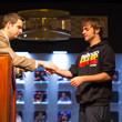 Jack Effel handing Bryan Campanello his gold bracelet