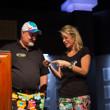 Julie Schneider presents her husband Tom with the gold bracelet